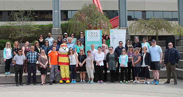 City of Windsor and University of Windsor staff in a group shot with guests for the Sole Focus walk
