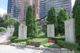 Three cement slabs with one negative relief pilot on each. Atop each slab is a model plane. All surrounding two bronze plaques in a semi-circle.