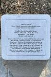 Plaque in tribute to friends who made memorial possible.