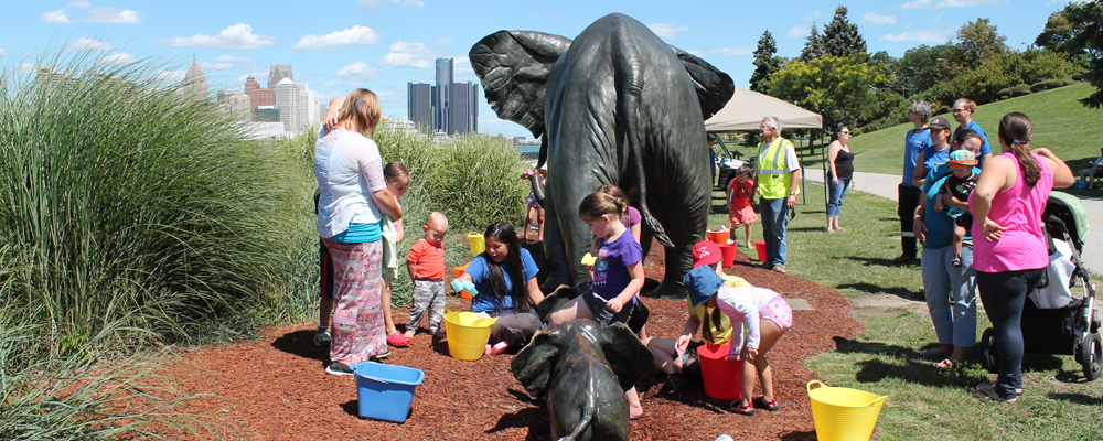 The public gathers to wash the Tembo elephant sculpture