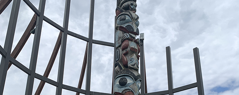 Detail of a tall toem pole.