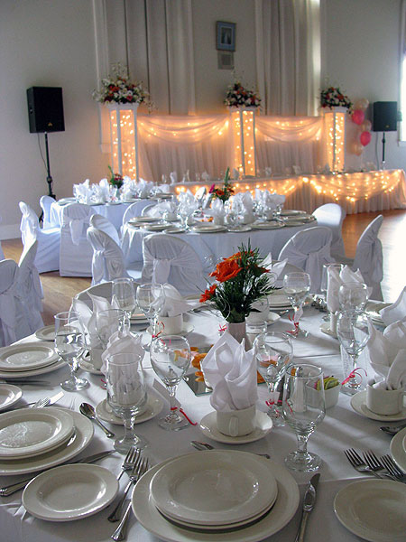Place settings in preparation for a reception