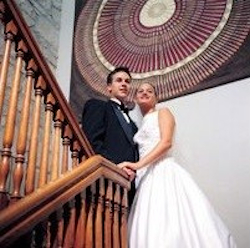 Wedding couple on staircase landing