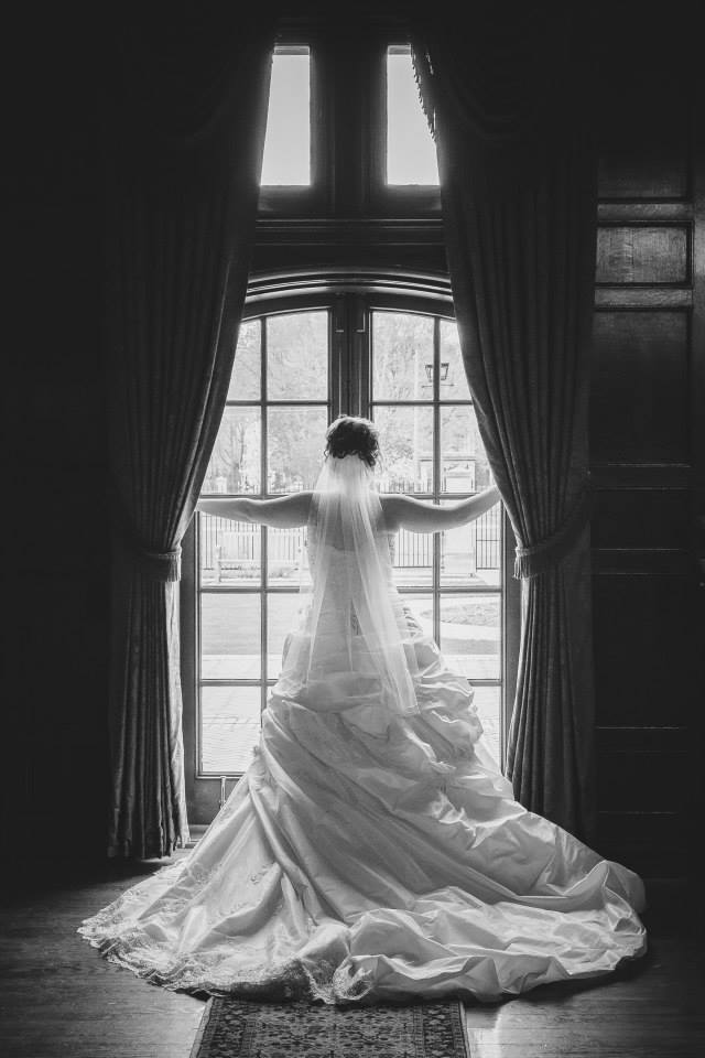 Bride framed by glass doors