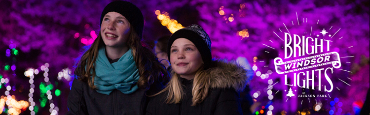 Two young sisters in awe of the illumination