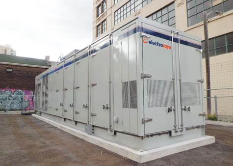 Large battery storage unit adjacent to a multi-level building