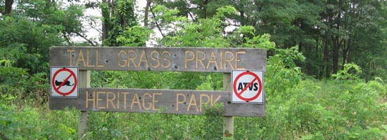a close shot of the signage at the Tallgrass Prairie Heritage Park