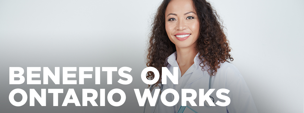 A smiling woman holding a file with the words Benefits on Ontario Works